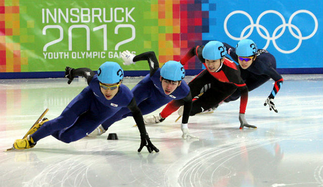 Yoon Su-min (left) and Lim Hyo-jun (second from left) of South Korea are on their way in the men's 500-meter short-track speed skating race at the inaugural Winter Youth Olympics on January 19