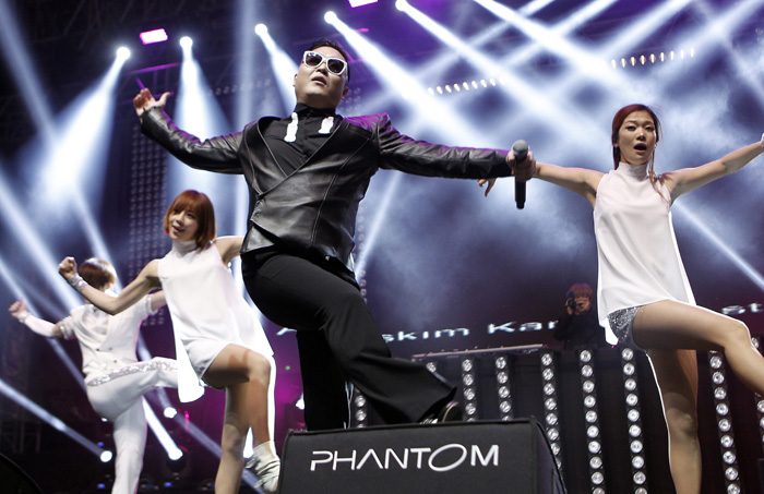 "South Korean singer PSY performs during a concert at the Tepebasi Arena in Istanbul, Turkey on February 2013. Since his debut on the global stage with the hit song ""Gangnam Style,"" he has been making more appreances in both the domestic and international music scenes (photo: Yonhap News)."