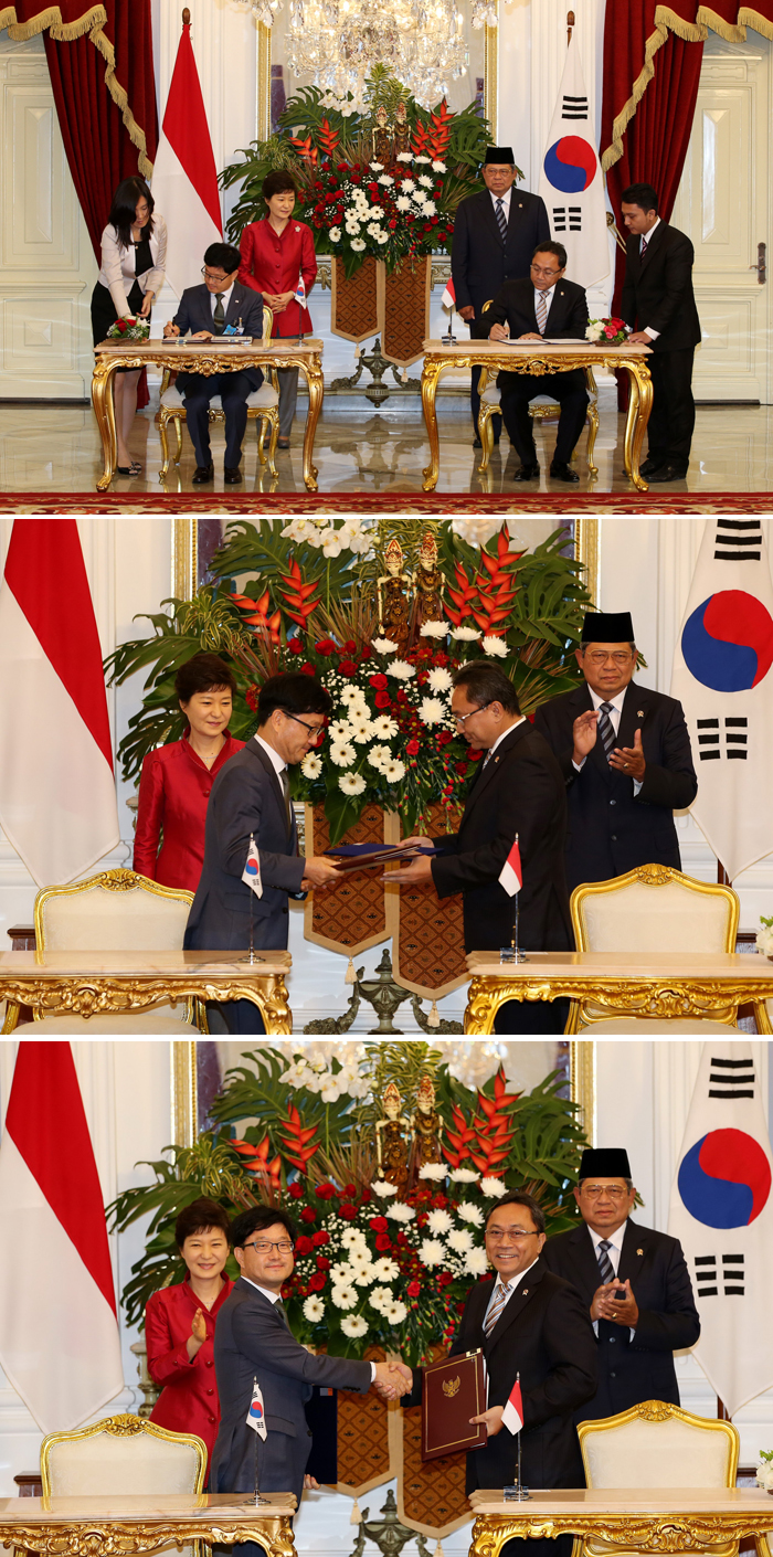 Representatives from the Korea Forest Service (KFS) and Indonesia's Ministry of Forestry sign an MOU, with the two presidents in attendance. (photos courtesy of the KFS)