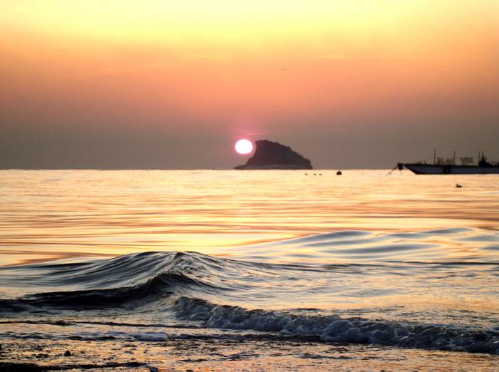 "The sunset falls behind Maerangdo Island, or ""Shark Fin"" Island, off of Geojampo."
