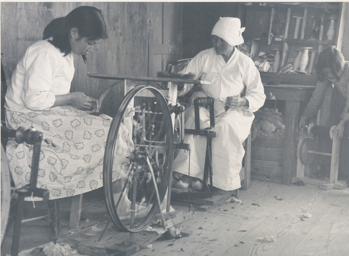 Female employees are producing wool fabrics.