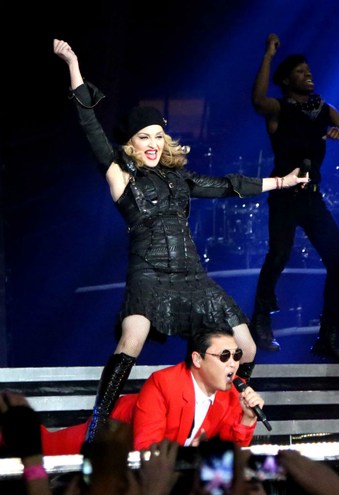 PSY was invited by Madonna to perform his signature horse dance together on stage in November 2012. (photo: Yonhap News)