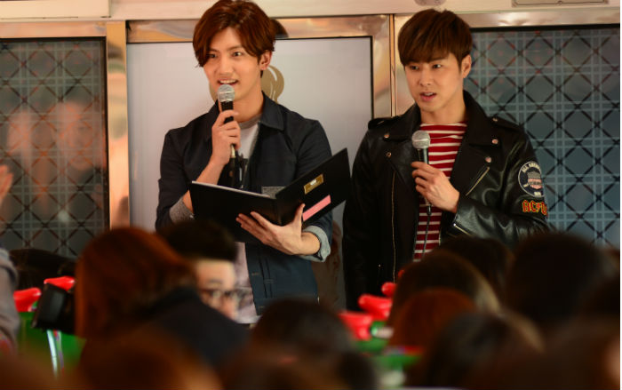 The members of TVXQ, Max Changmin (left) and U-know Yunho, hosted a train trip across Korea for around 250 of their fans on March 24.