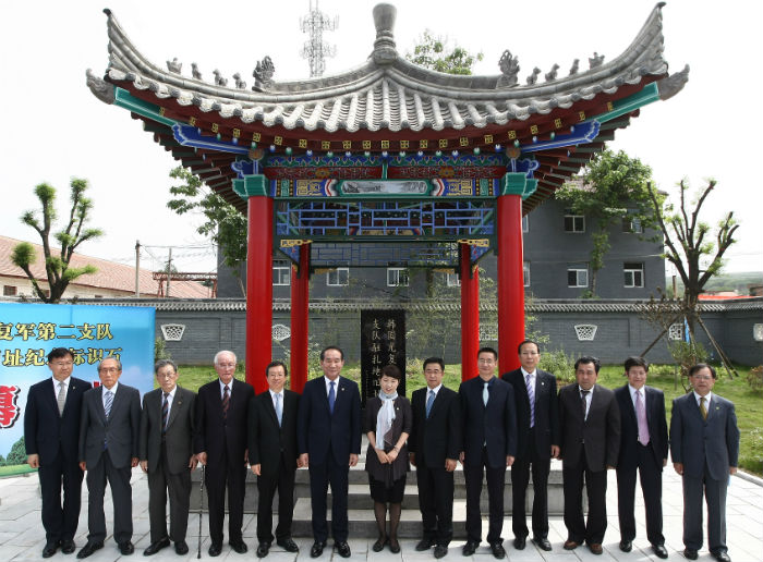 Government officials from Korea and China attend the unveiling ceremony for the commemorative monument. (photo courtesy of the Ministry of Patriots and Veterans Affairs)