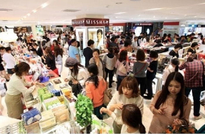 The streets and stores of Myeongdong are packed with tourists and shoppers.