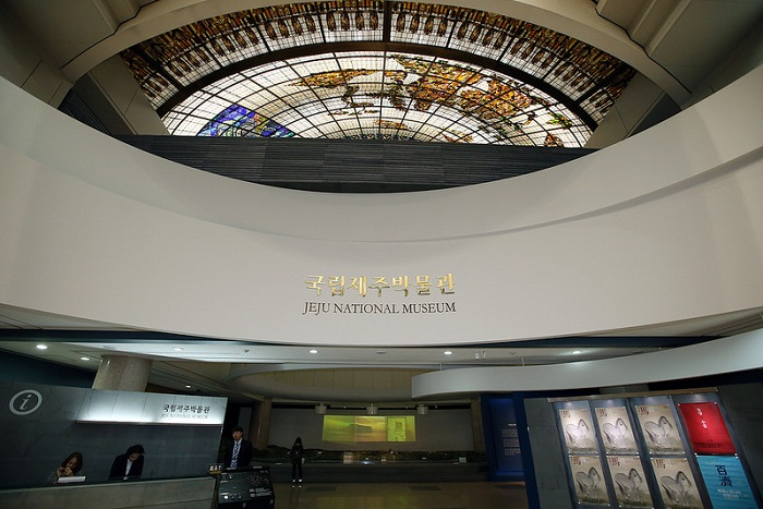 The museum's central hall is adorned with stained glass portraying the island's founding myth of Hallasan Mountain and three abundant items: lava stones, wind and the womenfolk.