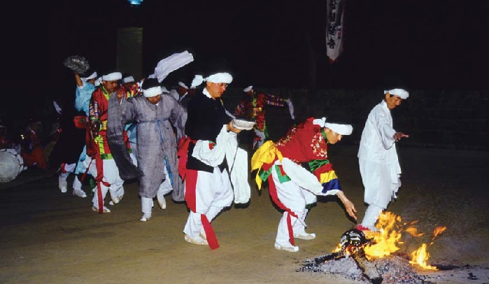 Dancers burn their masks after a performance.
