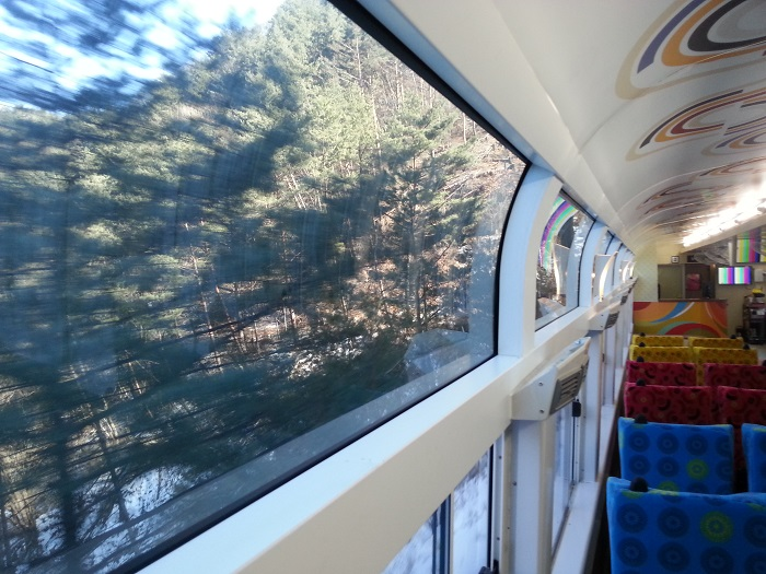 The A-Train is decorated with colorful designs and is equipped with comfortable seats and large windows.
