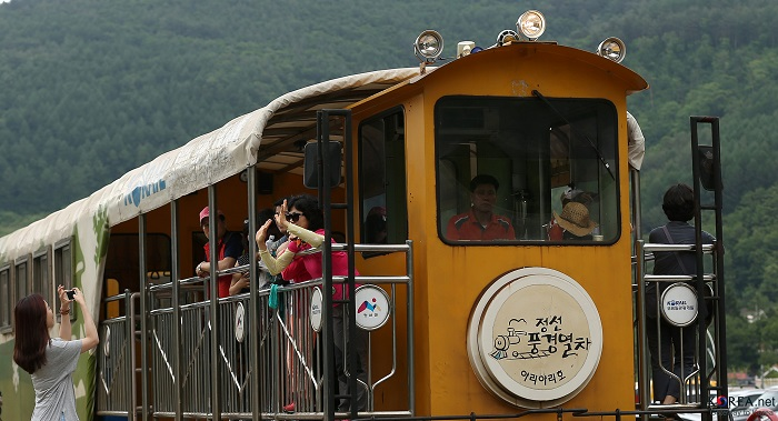 Tourists take photos at around Scenery Train railroad.