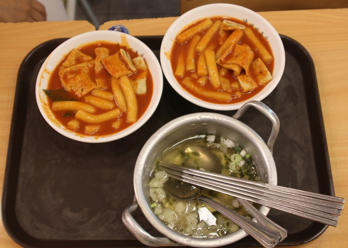 The streets of Bukchon are lined with beautiful and cozy cafés and restaurants, as well as street stalls selling popular snacks like <i>tteokbokki</i>, ice cream, waffles and whatever else the chefs can think of.