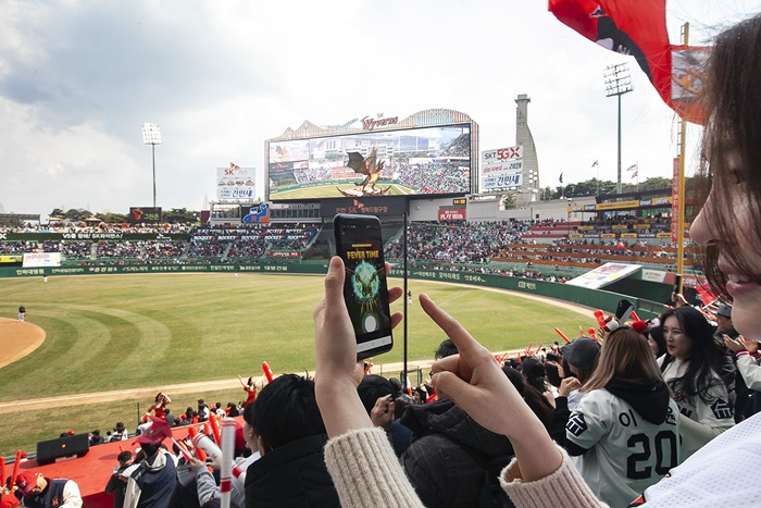 Augmented reality dragon wows baseball fans on opening day