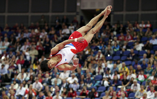 South Korean gymnast Yang Hak-seon performs his signature triple-twisting handspring front somersault at the London 2012 Olympic Games. Yang's performance secured South Korea's first ever gymnastics gold medal (photo: Yonhap News).