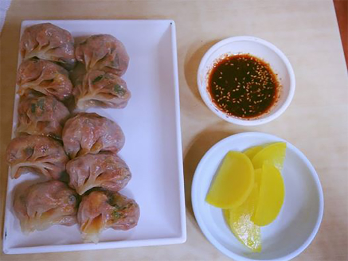 Kimchi dumplings can be found in the Gaegeum Traditional Market.