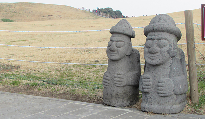 <i>Dol hareubangs</i> are greeting my visit to the Jeju Island. They are large rock statues and are considered to be gods offering both protection and fertility.