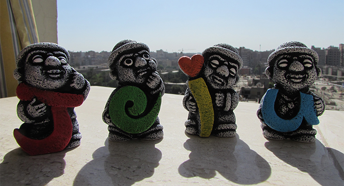 Cute <i>Dol hareubangs</i> souvenirs holding each letter of the Island.