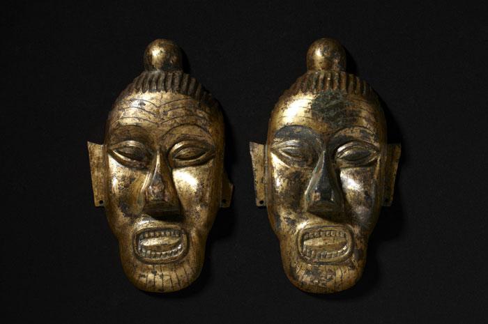Face-shaped ornaments, Buyeo (c. 200 B.C.-A.D. 494), gilt bronze, 27.4cm high.