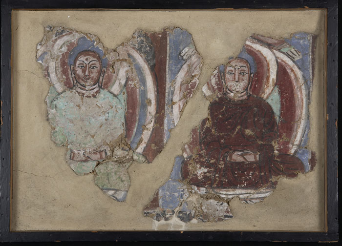 Mural fragment with Thousand Buddhas, Bezekilk Cave 18, Turpan, 6th-7th century, color on clay, 32.5 x 46.5cm.