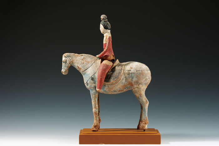Lady riding a horse, Astana Tombs, Turpan, 7th-8th century, color on clay, 38.5cm high.