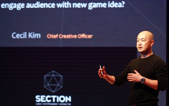 Creative director Cecil Kim talks about the secret to making a video game look like a movie, during his speech at the 2014 Content Insight seminar. (photo courtesy of the KOCCA)