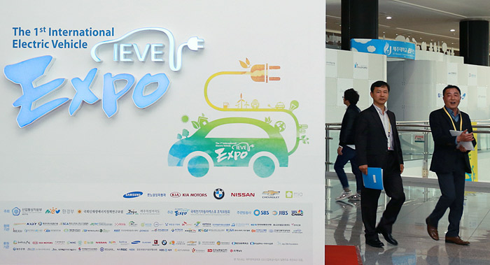 Visitors look around the venue of the first International Electric Vehicle EXPO. (courtesy of the International Electric Vehicle EXPO)