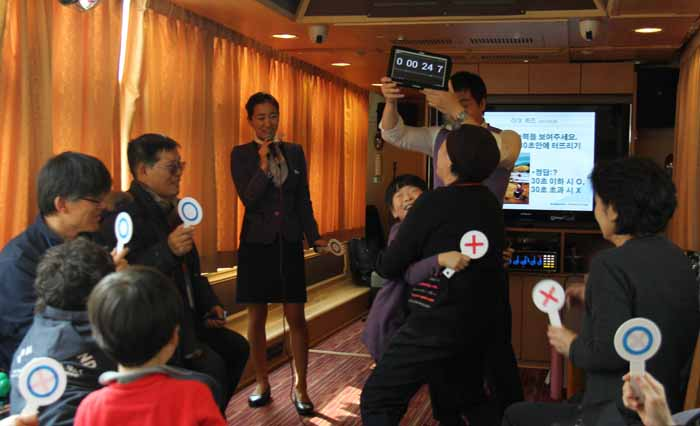 Haerang passengers take part in the true-or-false quiz in the Four Seasons room.
