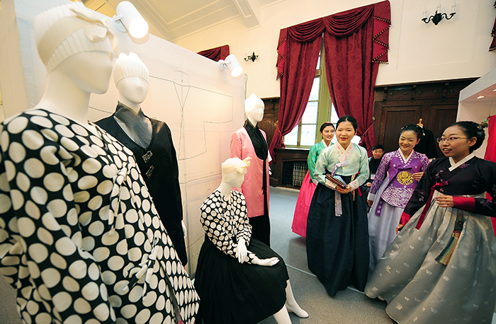 Hanbok wearers look at new Hanbok designs on display during Hanbok Day.