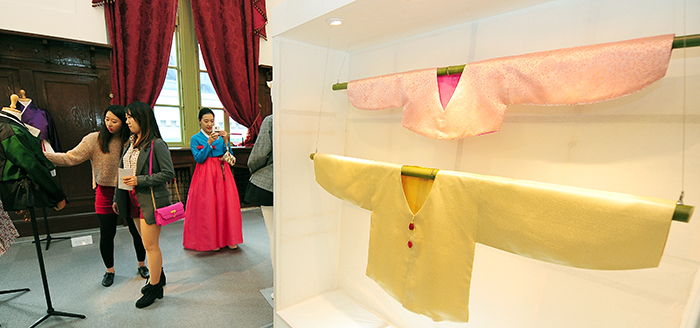 People look around the Hanbok on display during the Hanbok Day events.
