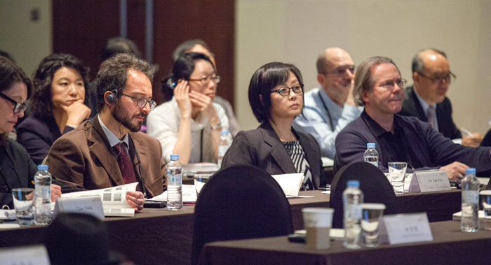 Participants in the 'International Seminar on Innovative Traditional Korean Paper, Hanji,' listen as a series of speakers deliver their remarks.