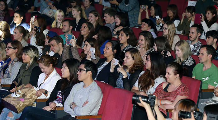 Overseas students enjoy the performances during the first 'Hello, Mr. K' concert on May 15.