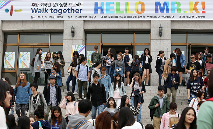 Students leave the auditorium after enjoying the 'Hello, Mr. K' concert on May 15. The next concert will be held on May 29 at the USFK's Osan Air Base.