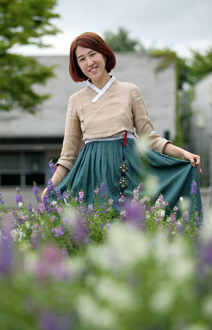 Sonjjang Design Hanbok CEO Hwang Yi Seul wearing her own design (photo: Jeon Han)