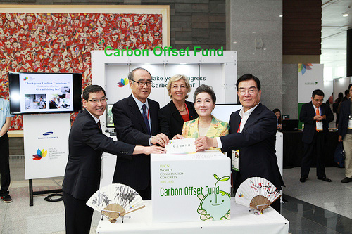 Minister of Environment Yoo Young-sook (second from right), IUCN Director General Julia Marton-Lefèvre (third from right), and Chairman of the Korean Organizing Committee for the 2012 WCC Lee Hong-koo (second from left) pose together in front of the Carbon Offset Desk at the 2012 World Conservation Congress exhibiton area, where visitors can make voluntary contributions to offset their carbon footprints (photo courtesy of IUCN).