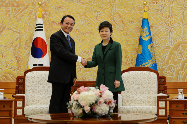 President Park shakes hands with Japanese Deputy Prime Minister Taro Aso (photo courtesy of Cheong Wa Dae).