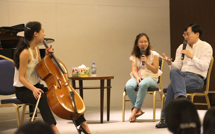 Chinese cellist Jian Wang (right) instructs a student during the Cello Master Class on July 26. The GMMFS also holds a music school targeting around 140 young promising musicians from twelve nations, with participation from domestic and international musicians to share their musical expertise and skills (photo courtesy of Communique).