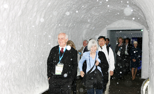 Visitors to the Climate and Environment Pavilion walk through a blizzard tunnel