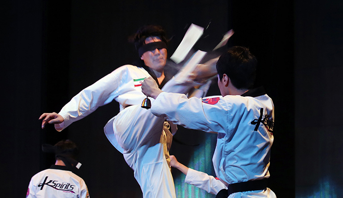 Korean and Iranian athletes demonstrate their taekwondo moves in the Korea-Iran One Heart Festival at the Milad Tower in Tehran on May 2. Taekwondo is so popular in Iran that more than 2 million people train in the martial art.