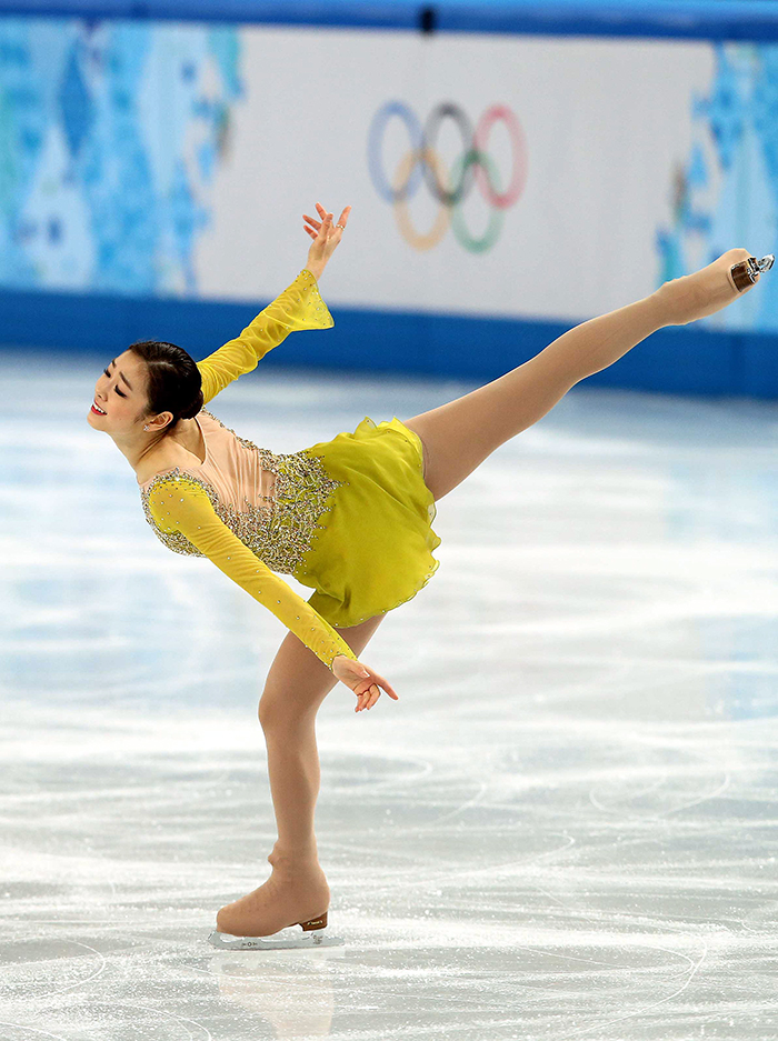 "Kim Yuna performs an elegant spiral to ""Send in the Clowns"" in the ladies' short program at the Sochi 2014 Winter Olympics. (photo courtesy of the Korean Olympic Committee)"