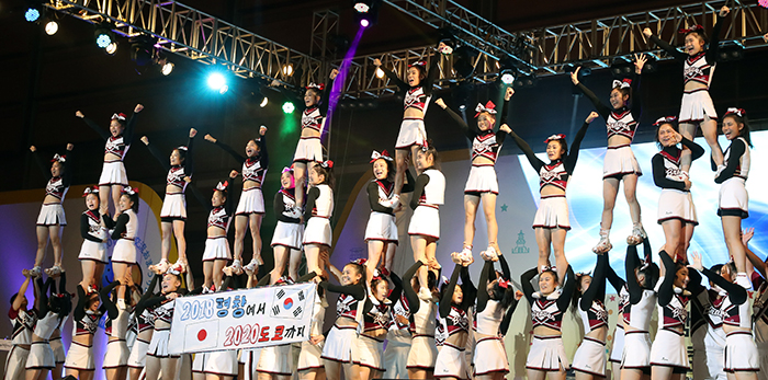 The cheerleading team Braves from Nippon Bunri University performs to mark the PyeongChang 2018 Olympic and Paralympic Winter Games and the Tokyo 2020 Olympic and Paralympic Games, during the opening ceremony for the Korea-Japan Festival in Seoul on Sept. 24.