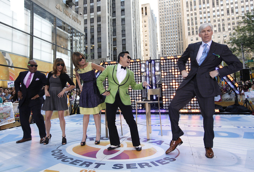 Korean rapper Psy, center, teaches hosts, from left, Al Roker, Natalie Morales, Savannah Guthrie and David Gregory some of his signature dance moves before performing his massive K-pop hit Gangnam Style live on NBC's Today show, Friday, Sept. 14, 2012, in New York. (Photo: Jason DeCrow/Invision/AP Images)