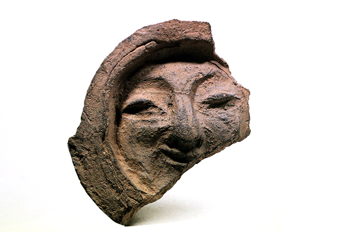 Roof-end Tile with Face Pattern. Silla. Gyeongju National Museum.