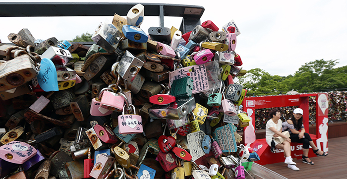 The 'padlocks of love,' locked to the railings and fences at the base of N Seoul Tower, show the importance of love to people from all over the world, stretching beyond history, culture, religion or region. (photo: Jeon Han)