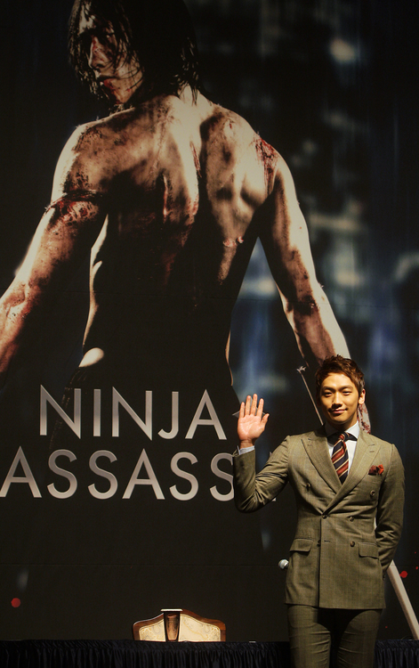 Main actor Rain poses in front of a film poster to promote his film <I>Ninja Assassin</I> at Lotte Hotel in central Seoul in November 2009 (photo: Yonhap News).