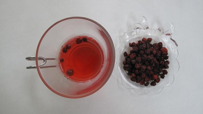 <i>Omija</i> tea and dried <i>omija</i> berries (image courtesy of the Rural Development Administration)