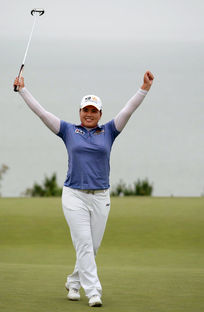 Park raises her arms to celebrate her victory after finishing the U.S. Women's Open on July 1 (photo courtesy of JB Worldwide).