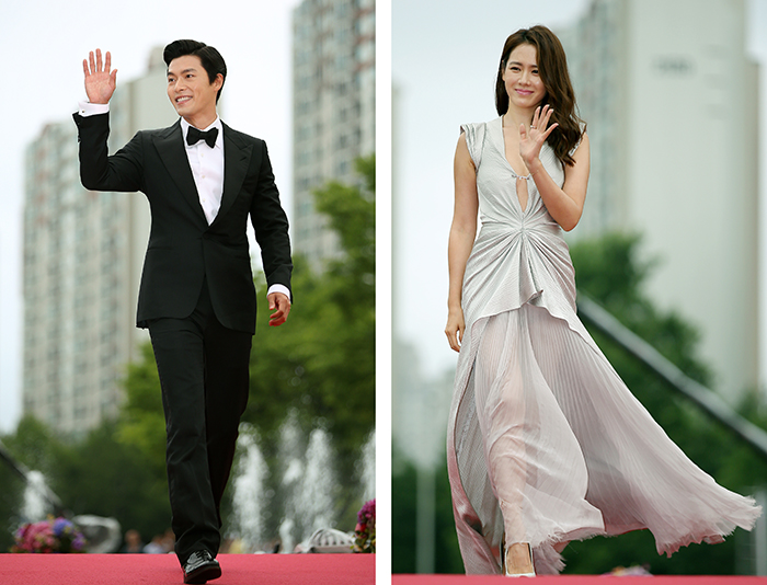 Hyun Bin (left) and Son Ye-jin walk down the red carpet during the opening ceremony for the 18th Puchon International Fantastic Film Festival on July 17. They each received a Producers' Choice Award. (photos: Jeon Han)