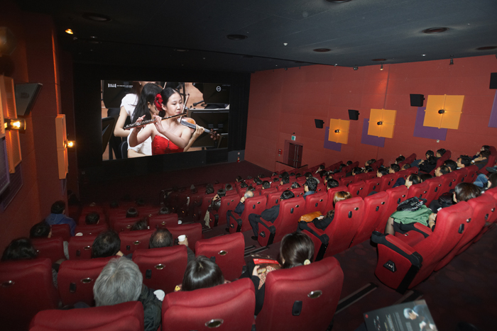 Spectators watch the live performance on screen at a CGV theater. (photo courtesy of the SAC)