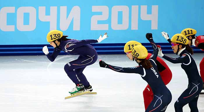 Shim Suk-hee leads a dramatic finish by catching up with Chinese skater Jianrou Li in the ladies' 3,000 meter short track relay finals on February 18. The other two members of Team Korea celebrate their win. (photo courtesy of the Korean Olympic Committee)