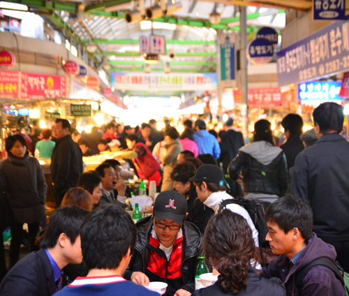 Eating in Gwangjang Market is a communal experience.