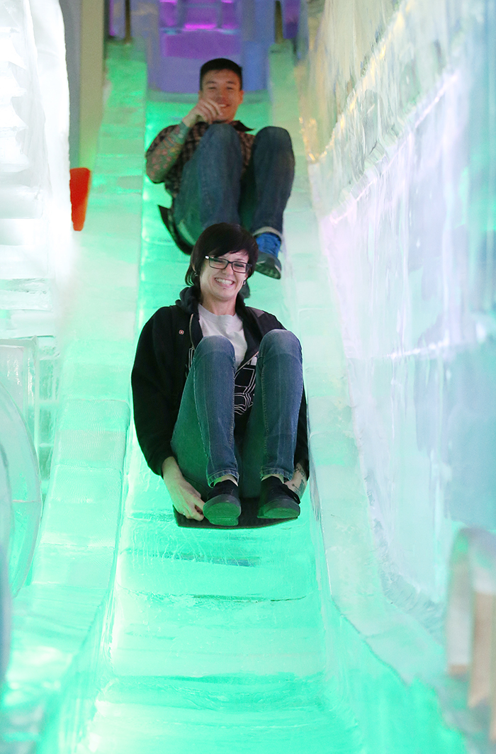 Sam (front), visiting the museum with her friend, enjoys going down the ice slide in the Ice Museum room at the Trickeye Museum. (photo: Jeon Han)