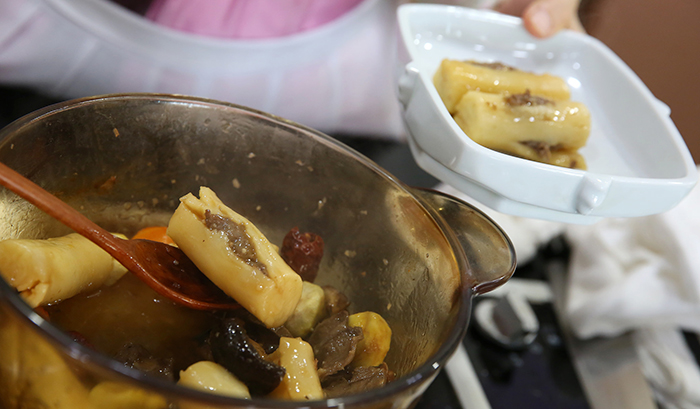Mix In The Ginkgo And Pine Nuts Serve The Dish On A Plate With Slices